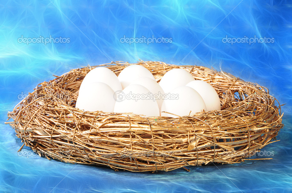 White eggs in golden nest on mystic blue background — Stock Photo #1019448