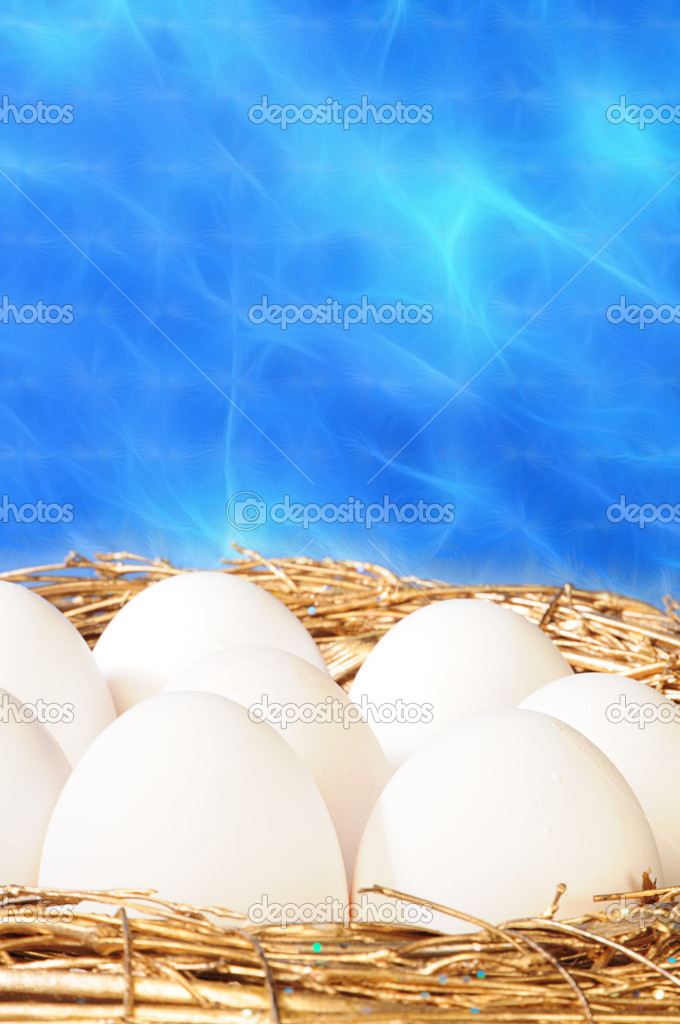 White eggs in golden nest — Stock Photo #1019474