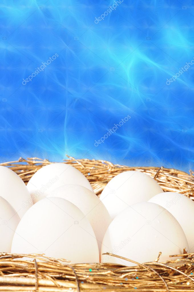 White eggs in golden nest  Foto Stock #1019474