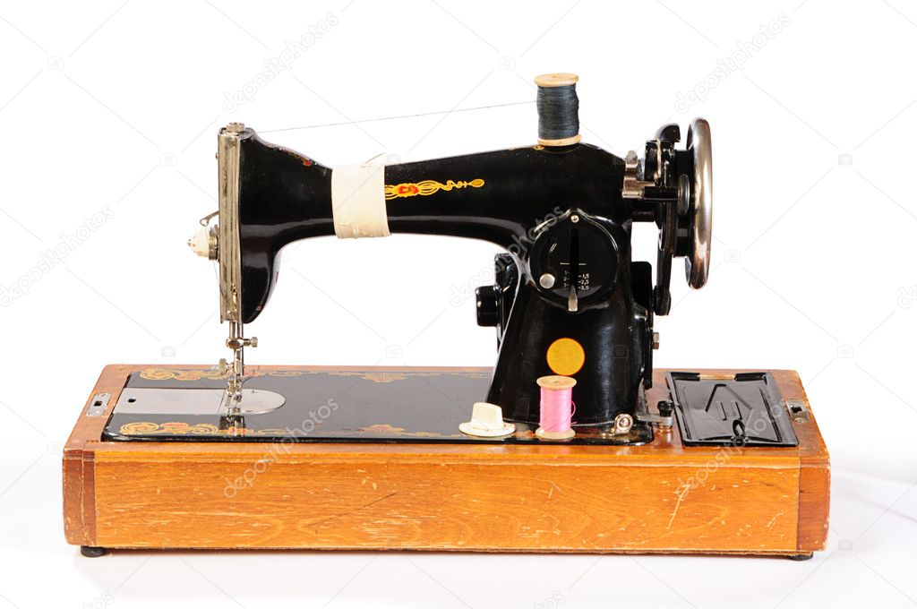 Old sewing machine isolated on white  Stock Photo #1021022