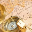 Old-fashioned compass on map — Stock Photo