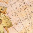 Royalty-Free Stock Photo: Old map with old-age navigation device