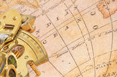 Old map with old-age navigation device — Stock Photo