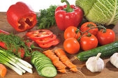 Vegetables on board — Stock Photo