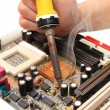 图库照片: Repair of motherboard