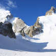 Great glacier and a group of climbers — Stock Photo