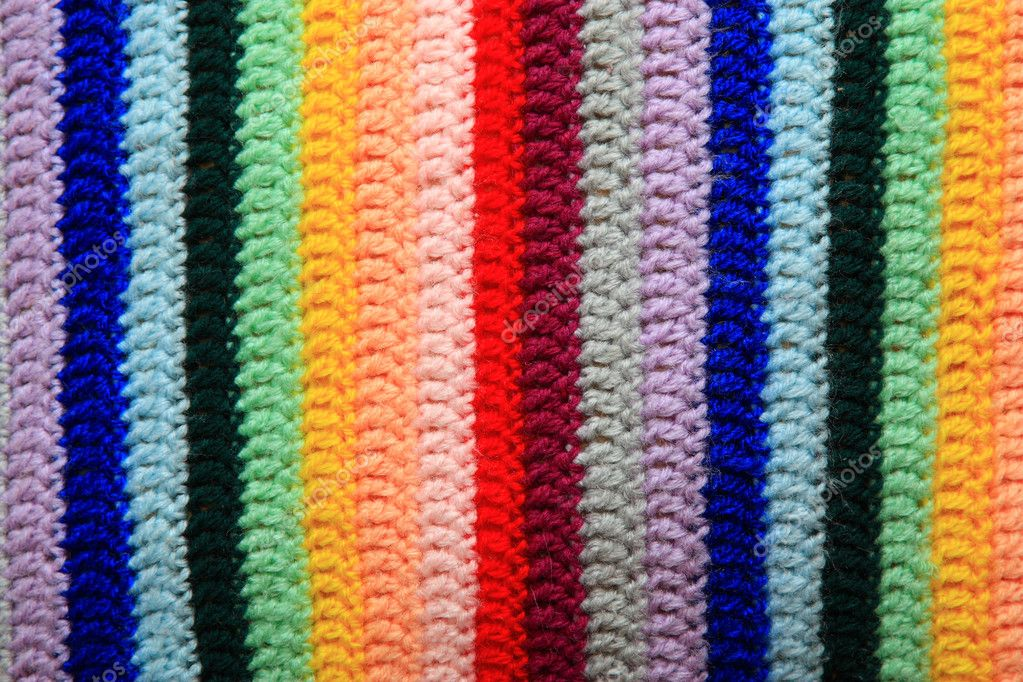 Fabric knitted from woollen threads of different colours. The order of colours was selected by the psychologist — Stock Photo #1033508