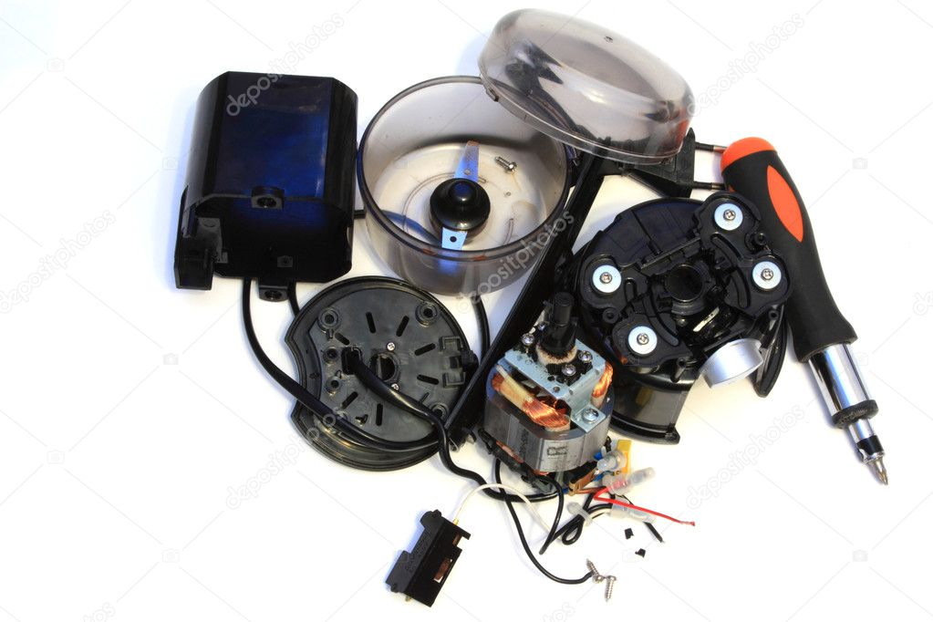 Elements of the coffee grinder disassembled after breakage on a white background — Stock Photo #1033561