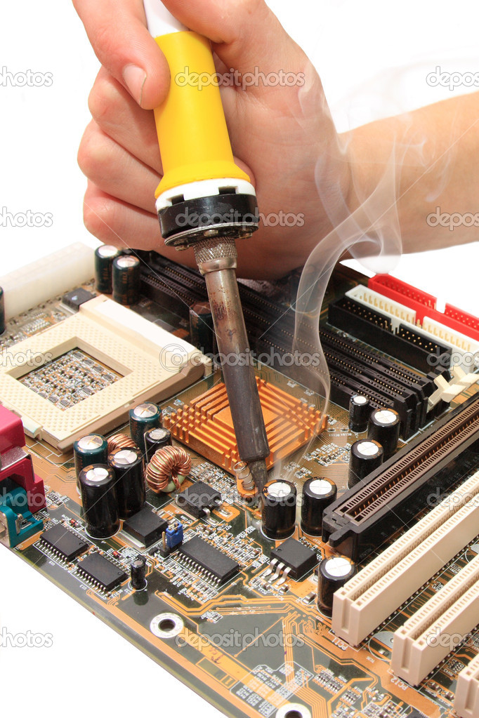 Replacement of broken capacitors on the motherboard by CU  Stock Photo #1033657
