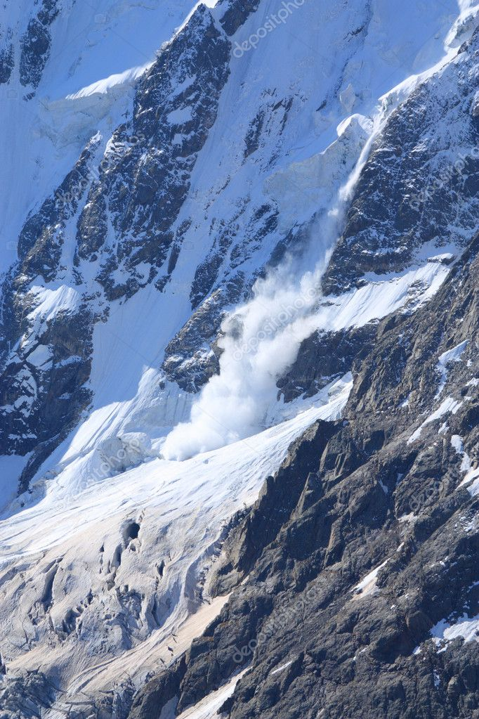Avalanche moves down the slope huge mountain — Stock Photo #1033765