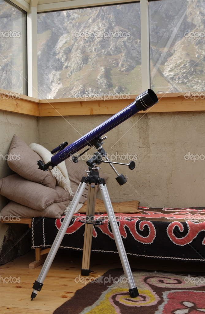 Telescope in the attic room in the old style — Stock Photo #1033824