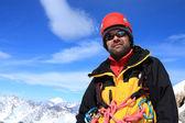 Alpinista no topo — Foto Stock