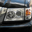 Stock Photo: 4x4 jeep`s head light.