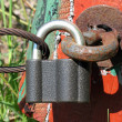 Old rusty padlock with wire. — Stock Photo