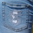 Royalty-Free Stock Photo: Jeans skirt pocket`s extreme close- up.