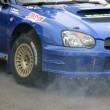 Stock Photo: Fuming engine of rally car.
