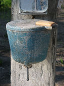 Old village wash stand with soap. — Stock Photo