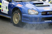 Fuming engine of rally car. — Stock Photo