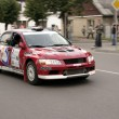 Stock Photo: Red rally car on street.