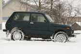 4x4 russian jeep in snow. — Stock Photo