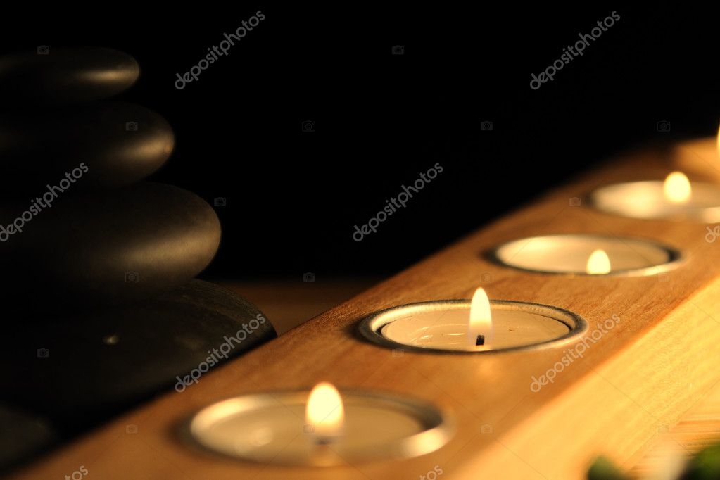 Bamboo,zen stones and candlestck on the black background — Stock Photo #1024539