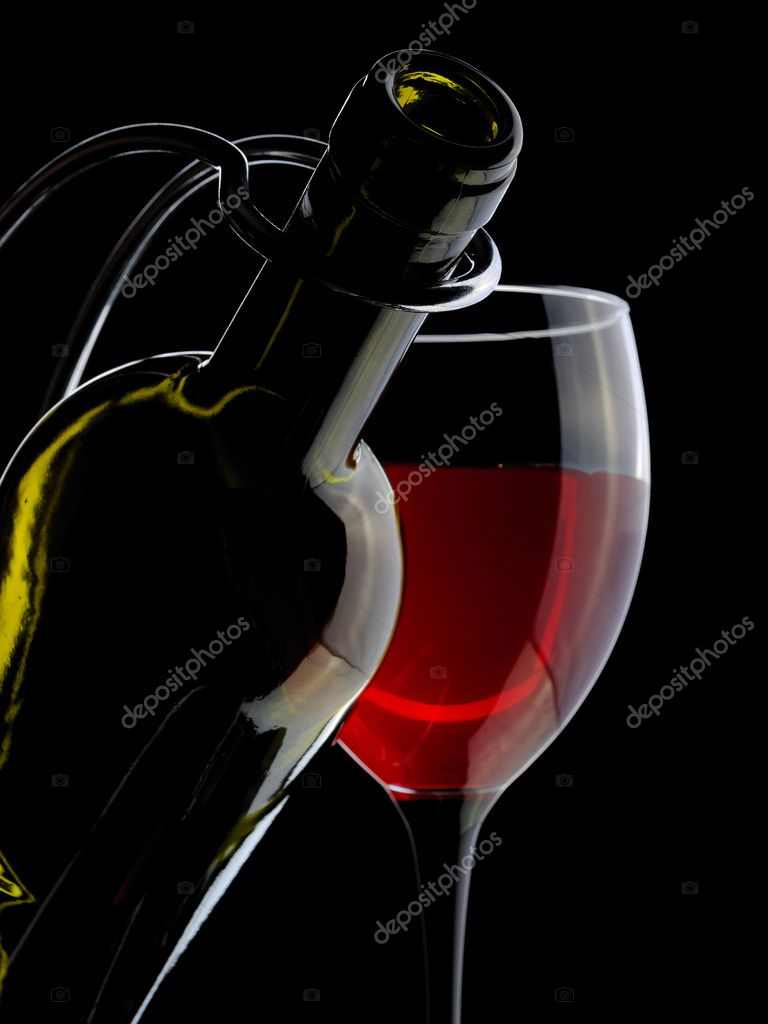 wine bottle and glass on the black background — Stock Photo #1623053