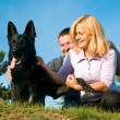 Young couple with dog — Stock Photo #1015021