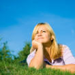 Woman lie on green grass — Stock Photo