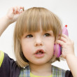Child with toy phone — Stock Photo #1018271