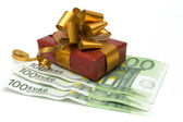 Money and gift — Stock Photo