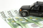 Money and car — Stock Photo
