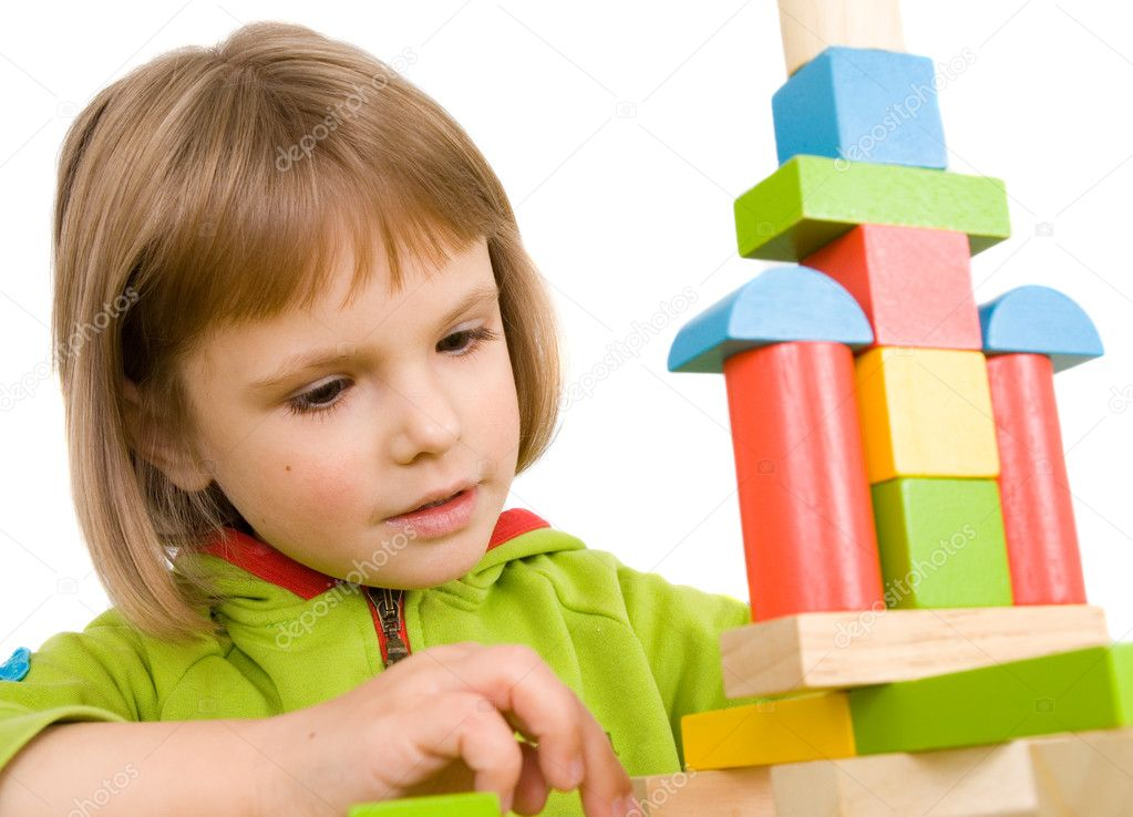 Child plays with toy blocks — Stock Photo #1016904