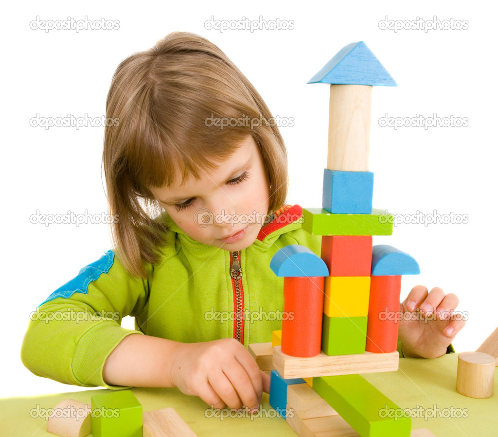 Child plays with toy blocks  Stock Photo #1016929