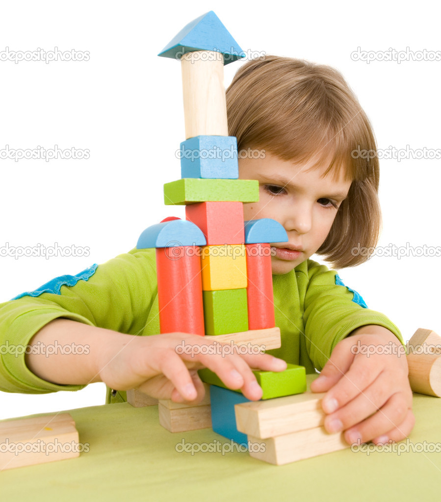 Child plays with toy blocks — Stock Photo #1016948