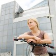 Girl on bike — Stock Photo