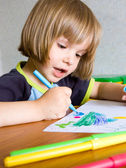 Child draws — Stock Photo