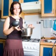 Woman on kitchen — Stock Photo