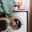 Man and a washing machine - Stock Photo