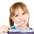 Girl brushing her teeth — Stock Photo