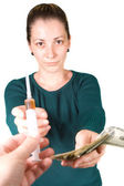 Woman with money and syringe — Stock Photo