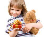 Child and gift — Stock Photo
