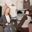 Two women in clothes shop — Stock Photo