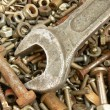 Rusty metal fasteners and  wrench — Stok fotoğraf