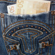 Royalty-Free Stock Photo: Money in pocket jeans