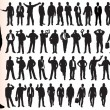 Silhouettes of many business - Stok Vektör