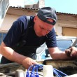 Stock Photo: Mrepairing old car