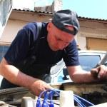 Man repairing an old car — Stock Photo