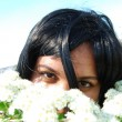 Black girl with white flowers — Stock Photo #1106621