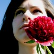 Stock Photo: Beautiful womwith red flower