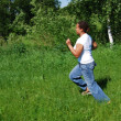 Black girl on green meadow — Stock Photo